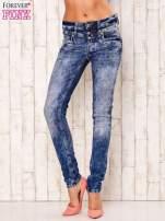 Niebieskie spodnie jeansowe marble denim z gwiazdką