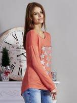 Pomarańczowa bluzka z nadrukiem cekinowych gwiazd                                  zdj.                                  5