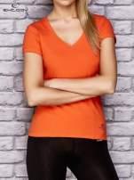 Pomarańczowy damski t-shirt sportowy z modelującymi przeszyciami                                  zdj.                                  1