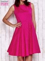 Różowa rozkloszowana sukienka w groszki