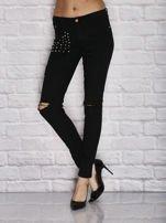 Spodnie rurki z dziurami i ćwiekami czarne                                  zdj.                                  1