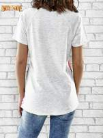 Szary t-shirt z kwiatowym nadrukiem i napisem UNREAL                                  zdj.                                  4