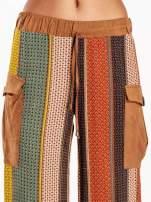 Wzorzyste spodnie palazzo z kieszeniami