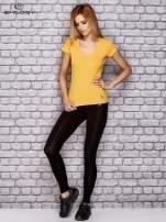 Żółty damski t-shirt sportowy z modelującymi przeszyciami                                  zdj.                                  4