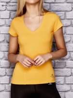 Żółty damski t-shirt sportowy z modelującymi przeszyciami                                  zdj.                                  1